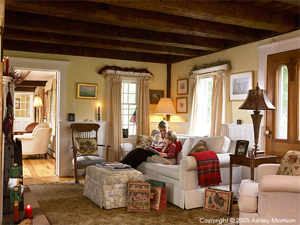 Jackie Ennis & her son, Callum, the living room of in their New England farmhouse near Stowe in Vermont.