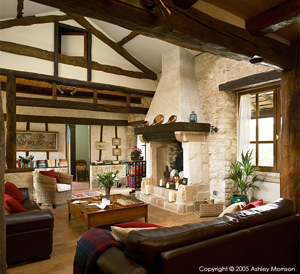 The fireplace in the living room in Angela & John Goodwin's Tower house in the Tarn region of France.