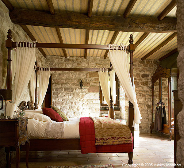 Four poster bed in the master  bedroom of Angela & John Goodwin's Tower house in the Tarn region of France.