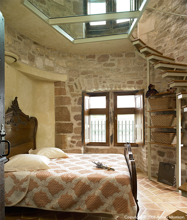 Guest bedroom in Angela & John Goodwin's 15th century Manoir or Tower house near the medieval hill village of Cordes sur ciel in the French Tarn region.