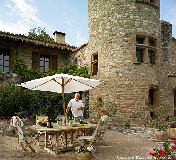 Angela & John Goodwin outside their 15th century Manoir or Tower house near the medieval hill village of Cordes sur ciel in the French Tarn region.