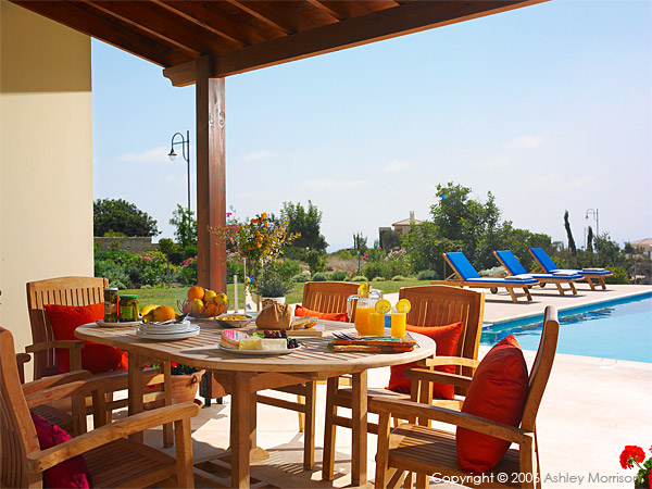 Table setting out at the pool at Villa Thalia at Aphrodite Hills near Paphos in Cyprus.