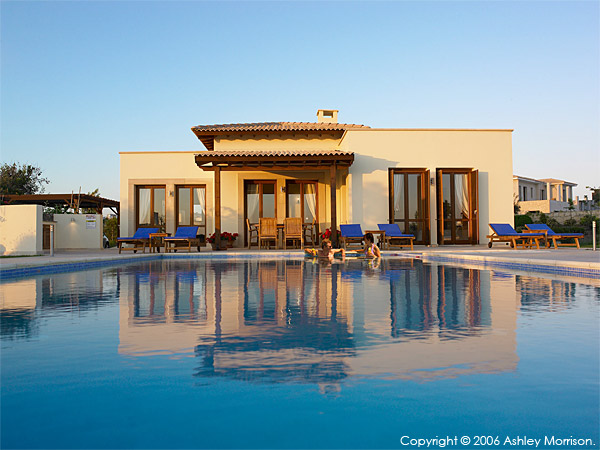 Karen and her husband in the pool outside Villa Thalia at Aphrodite Hills near Paphos in Cyprus.