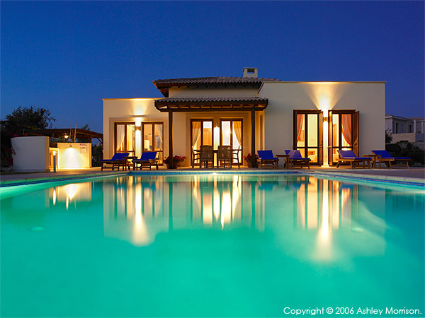 The swimming pool at night outside Villa Thalia at Aphrodite Hills near Paphos in Cyprus.