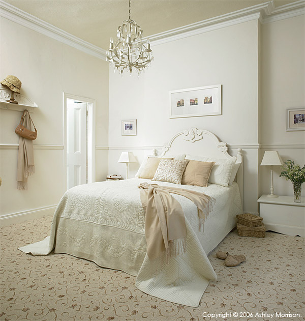 Lotus Scroll carpet by Ulster Carpets in the bedroom at Marie & Alan McMillen's home in Belfast.