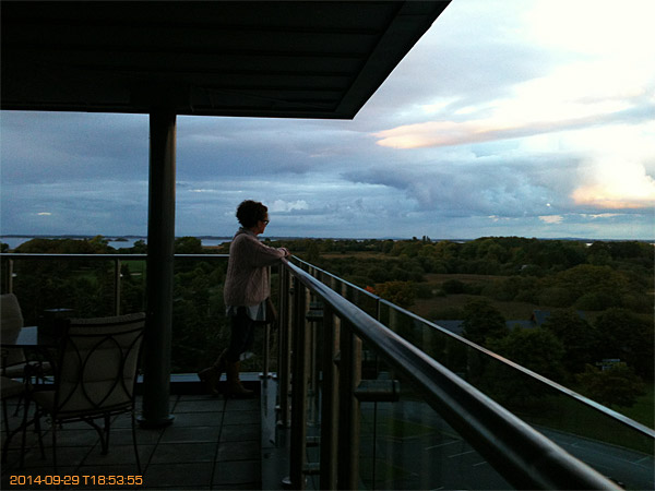 Marie standing on the balcony of Penthouse suite at the Hodson Bay Hotel