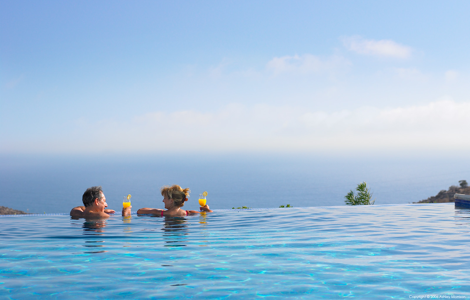 Rose and Julius Cohen in the infinity swimming pool outside their villa at the Aphrodite Hills complex in Cyprus.
